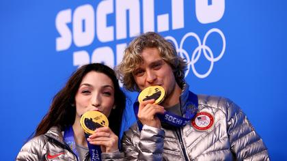 davis-white-kiss-medals-getty
