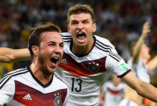 Germany's Goetze celebrates his goal against Argentina infront of teammate Mueller during extra time in their 2014 World Cup final at the Maracana stadium in Rio de Janeiro
