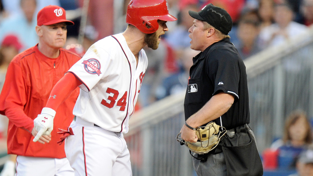 WASHINGTON, DC - MAY 20:  Bryce Harper #34 of the Washington Nationals argues with home plate umpire Marvin Hudson #51 after being thrown out of the game in the third inning against the New York Yankees at Nationals Park on May 20, 2015 in Washington, DC.  (Photo by Greg Fiume/Getty Images)