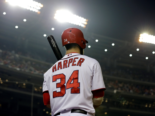 during the inning of a baseball game at Nationals Park Friday, April 12, 2013, in Washington. (AP Photo/Alex Brandon)